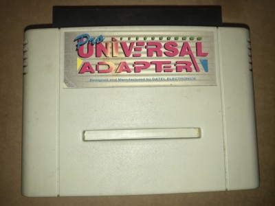 Super nintendo universal adapter. Play jpn and ntsc games on a pal snes